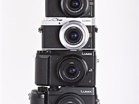 Look at this teetering stack of Panasonic cameras