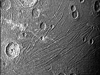 See the first images NASA's Juno captured as it sailed by Jupiter's giant moon, Ganymede