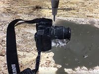 Slice and dice: Watch as a 60,000 PSI water jet slices an SLR in half