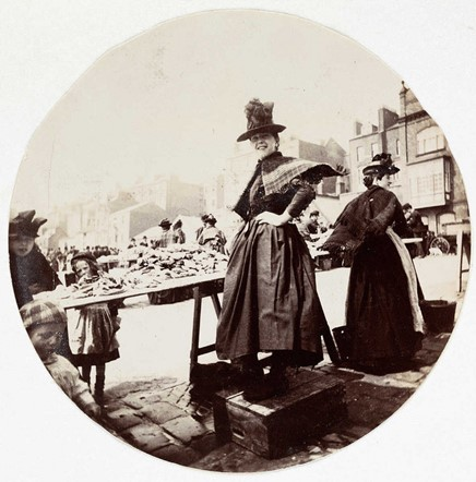 Woman at a market stall (<em>circa</em> 1890)