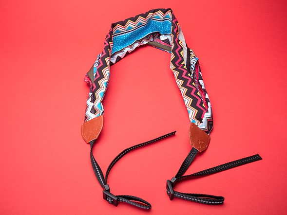 A stylish or overly-technical camera strap or camera bags