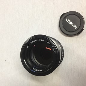 My Minolta 100/2.5 (49mm) for your  Minolta 100/2.5 (55mm) or Canon 100/2 FDn or M39