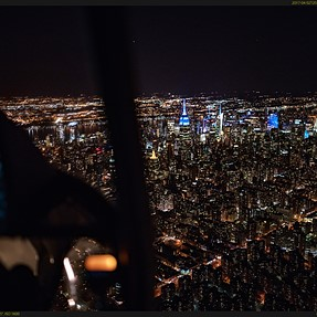 Hanging out of a helicopter @ night over NYC w/ the a99II & Otus