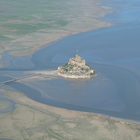 Mont St Michel at sunrise, the bay viewed from the sky ....
