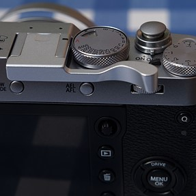 I can recommend this thumb grip for the X100F